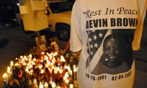 A Los Angeles resident wears a T-shirt with a picture of Devin Brown on it as she joins others at a makeshift memorial on 8 February 2005.