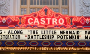 Exterior shot of the illuminated 'coming soon' sign on the front of the Castro Theatre, San Francisco, California, US