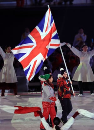 Great Britain's gold medallist Menna Fitzpatrick carried the British flag during the closing ceremony athletes' parade
