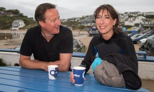 David Cameron and his wife Samantha have a coffee outside the Galleon Beach Cafe following an early morning swim in Polzeath.
