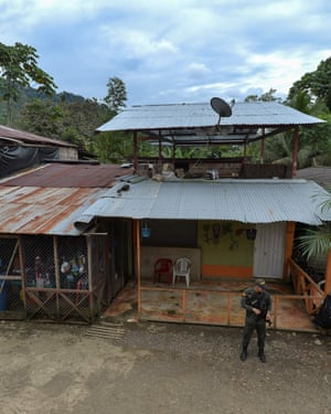 A police officer guards the streets of the town of Pie de Pato, Choco, western Colombia