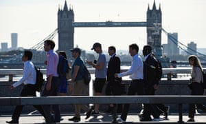 Office workers walk to their offices in the City of London
