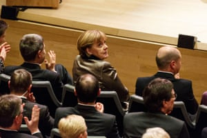 Chancellor Angela Merkel attends the opening concert of the Elbphilharmonie, with Hamburg mayor Olaf Scholz seated on her right.