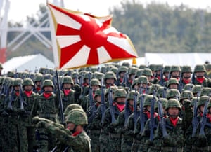 An infantry unit in Japan's self-defence force at a ceremony at Camp Asaka in 2016.