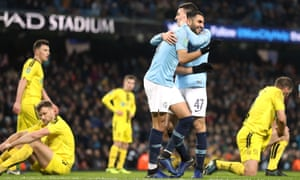 Manchester City's Riyad Mahrez (centre) celebrates scoring his side's ninth goal of the game with Phil Foden.