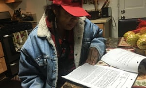 Leketha Williams, in her new home in Oakland, reviewing an old copy of her eviction lawsuit.