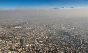 Aerial view of urban sprawl and smog in Mexico City, 2013.