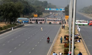 Buses block a highway to Islamabad as members of the Tehreek-e Labaik Pakistan party hold a sit-in in Rawalpindi.