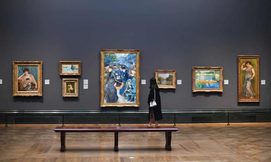 A woman walks through The National Gallery minutes before it closes until further notice, in London.