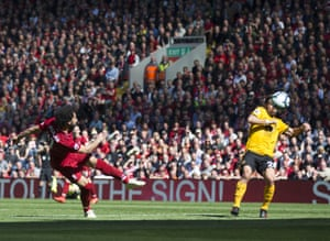 Salah hits the volley high.