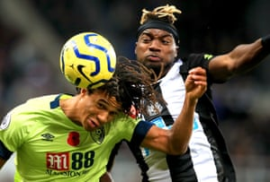 Bournemouth's Nathan Ake (left) and Newcastle United's Allan Saint-Maximin (right) battle for the ball at St James' Park. Newcastle came from behind to win 2-1.