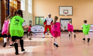 DeAndre Yedlin takes part in a skills session during a visit to a Newcastle primary school.