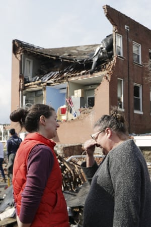 Debbie Jones, right, wipes tears as she views the damage to church she attended as a child.