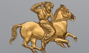 A gold plaque depicting a Scythian rider with a spear in his right hand.