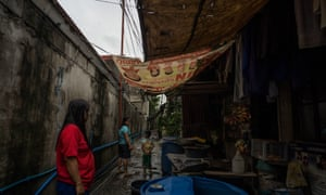 Residents of Canumay West village in Valenzuela City, who say they have taken to rubbing VapoRub under their noses to block the smell of burning plastic.