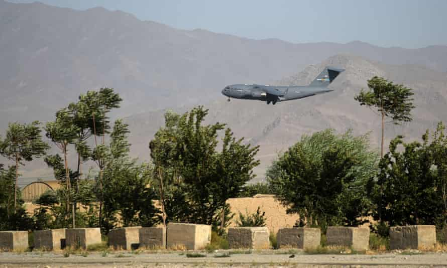 A US military air force plane flies over the military base in Bagram, north of Kabul.