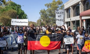More than 1,000 people marching through the streets of Alice Springs on Thursday following the news that a NT police officer, Zachary Rolfe, has been charged with the murder of 19-year-old Warlpiri man Kumanjayi Walker.