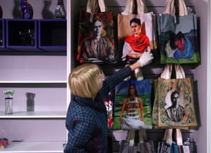 A woman browses a souvenir store full of Frida Kahlo-print tote bags at a Kahlo exhibition in Russia.