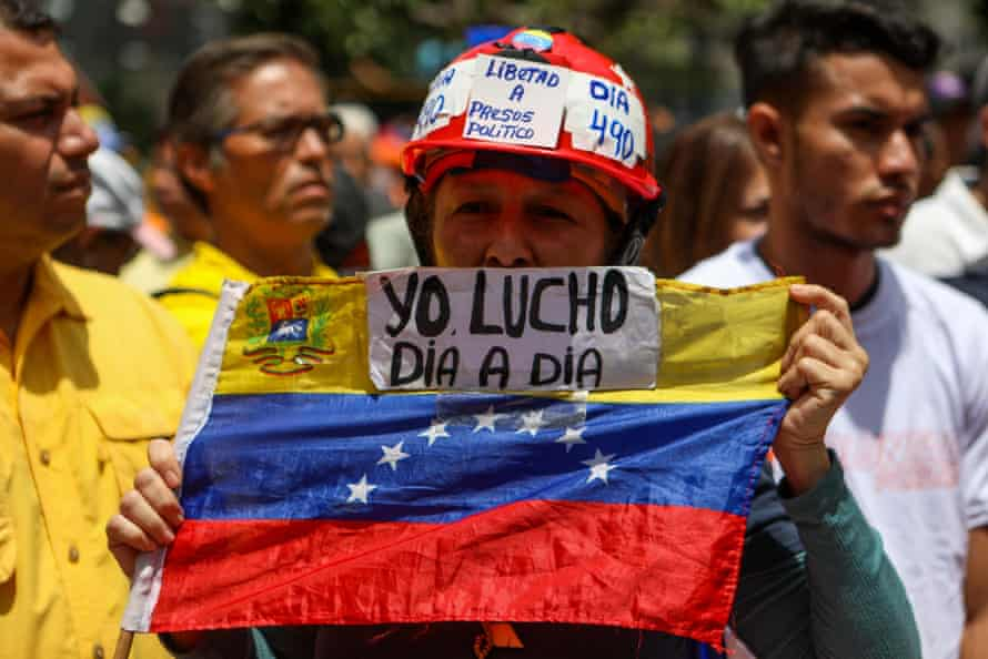 Opposition demonstrators are gathered during a protest against the government's economic measures in Caracas.
