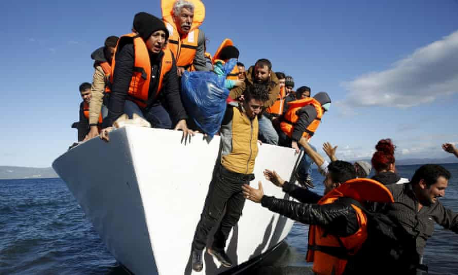 Refugees and migrants approach the Greek island of Lesbos after crossing the Aegean sea from Turkey