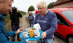 Boris Johnson offers  tea to journalists outside his home in Oxfordshire, August 2018.