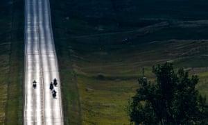 Motorcyclists ride down an empty road near Sturgis.
