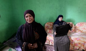 The mother of missing teenager Fares Ezzat, Meseda Abdel-Wahab, and his aunt at the family home near the town of Aga. Fares Ezzat is believed to have been among the estimated 500 people who drowned when a fishing boat carrying migrants, mostly from Somalia, Ethiopia and Egypt, capsized just off the coast of Egypt in April this year
