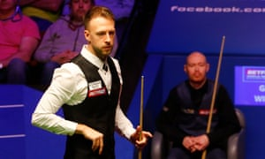 Judd Trump (left) twice recovered from going behind against Gary Wilson to take a 9-7 overnight lead.