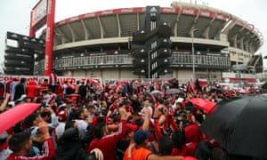River Plate fans wait for the team bus to leave the Monumental stadium before the first leg