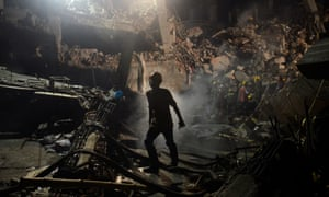 A Bangladeshi worker leaves the site where a garment factory building collapsed near Dhaka, Bangladesh in April 2013.