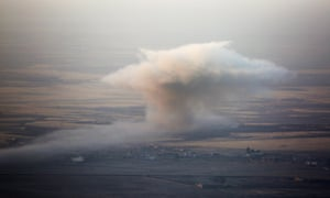 Smoke rises in Mosul's Bertela region after a coalition forces' airstrike over Isis targets