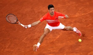 Novak Djokovic is a picture of concentration as he makes a return during his win