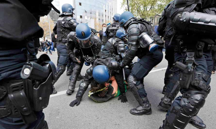 Police detain a suspect during a demonstration in Lyon