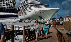 Tourists arrive from a cruise ship in St John's, Antigua on 11 December 2017.