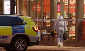 A police forensic officer works near the scene after a stabbing incident in Streatham