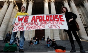 Protesters hold up a banner at the Occupy London Stock Exchange protest camp on the steps of St Paul's Cathedral, London, November 2011.