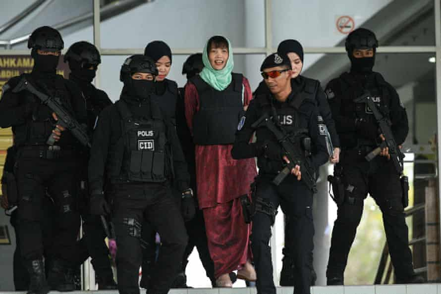 Doan Thi Huong is escorted by Malaysian police out of the high court in Shah Alam on 1 April.