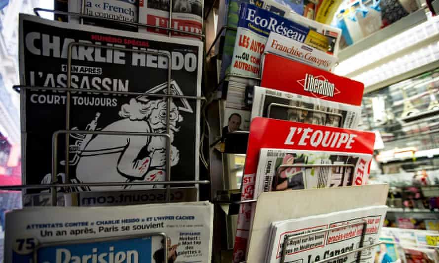 The Charlie Hebdo anniversary edition represents God as a terrorist bearing a gun.