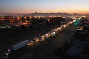 Vehicles line up to cross the US-Mexico border in El Paso, Texas, on 18 November.