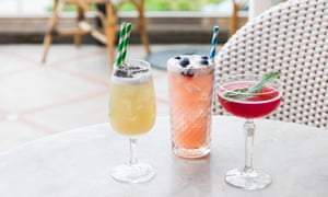 colourful cocktails by a wicker lounge chair