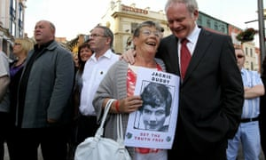 A relative of Bloody Sunday victim Jackie Duddy with Martin McGuinness on the way to gain a preview of the Saville Report in 2010 in Derry.