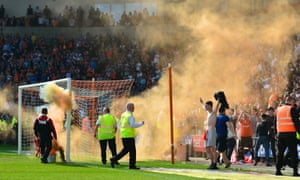 Blackpool fans celebrate their team's winning goal against Fleetwood on Monday.