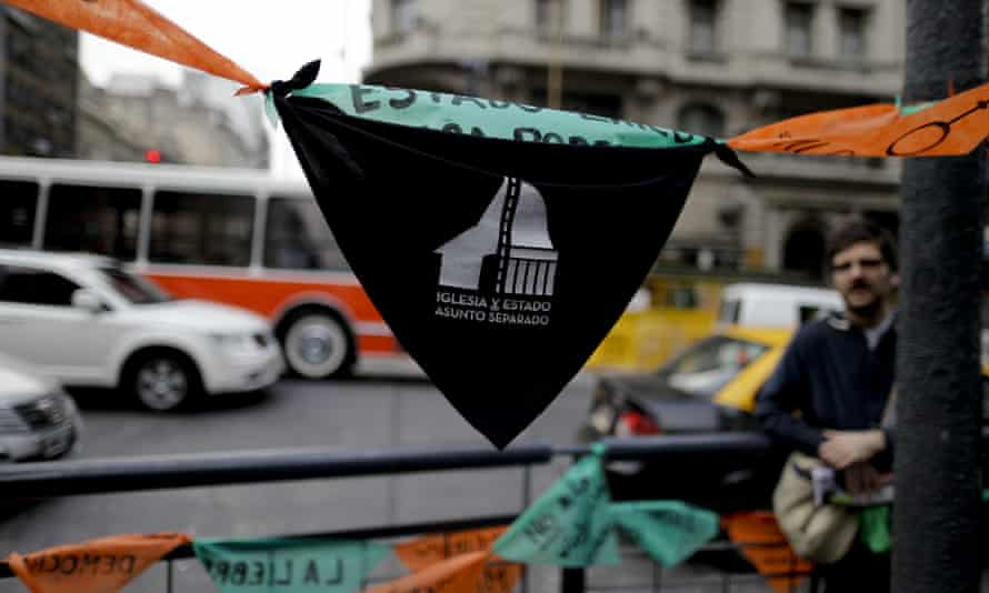 A handkerchief with text reading in Spanish 'Church and state – separate issues' in Buenos Aires