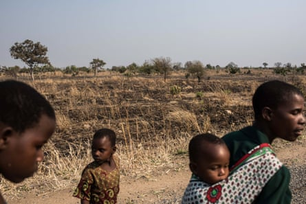Members of the Majawa family walk to their church in the village of Mulele, which lies in one of the areas most affected by drought in Zomba, Malawi.