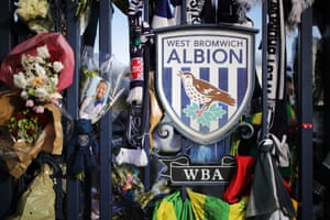 Flowers and tributes to Cyrille Regis left by supporters at the gates of the Hawthorns.