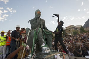 Students attack the defaced statue of Cecil John Rhodes at the University of Cape Town on 9 April.