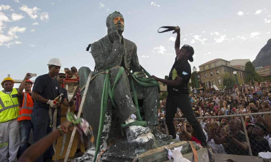 The defaced statue of British mining magnate and politician Cecil John Rhodes as it is removed from its position at the University of Cape Town.