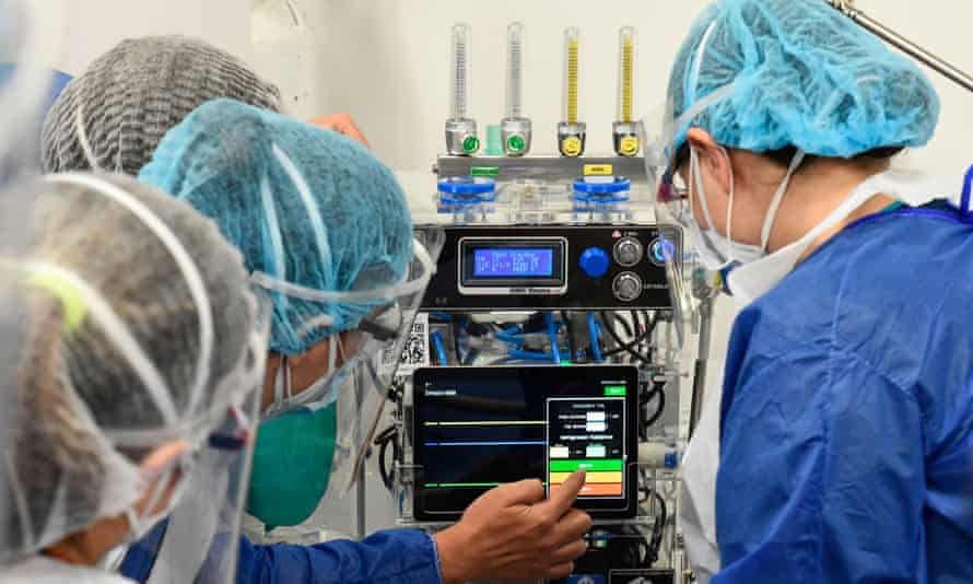 healthcare professionals and a ventilator