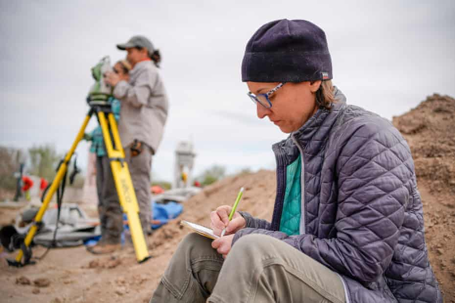Dr Kate Spradley takes notes while overseeing Texas State University graduate students exhuming bodies at the La Grulla cemetery.