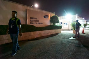 Workers (not interviewed by the Guardian) at the entrance to the Samsung plant in Port Klang